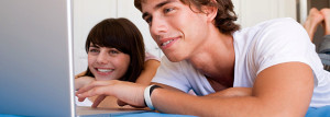 Teenage couple using laptop